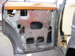 Rover p5b door with door card removed to repair lock.