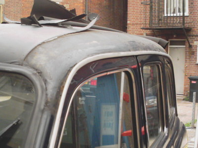 Removing the vinyl roof on a old taxi
